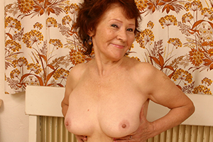 Phone sex granny takes her top off and shows of some great tits